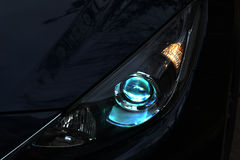 Alight neon car headlight. On the dark background Stock Images