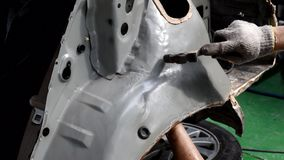 Align metal body car with hammer in automotive industry. Auto body repair shop stock video