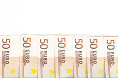 Aligned banknotes 50 euro european money on white background. Front and top view Stock Photo