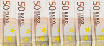 Aligned banknotes 50 euro european money on white background. Front and top view Royalty Free Stock Photo