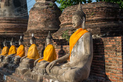 Aligned buddha statues. At Wat Yai Chaimongkol Ayutthaya Stock Photography
