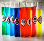 Aligned Chemical Danger pictograms - Toxic. Focus with colored test tubes Stock Photos