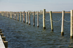 Aligned Empty Boat Slips/Piles in the Bay stock photography
