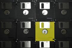 Aligned Floppy Diskettes. Black Aligned Floppy Diskette with yellow one Royalty Free Stock Photos