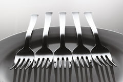 Aligned forks Royalty Free Stock Photography