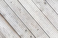 Aligned frozen striped plank boards in winter Stock Photography