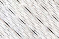 Aligned frozen striped plank boards in winter Stock Photo