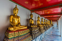 Aligned golden buddha statues Wat Pho temple bangkok Thailand Royalty Free Stock Images
