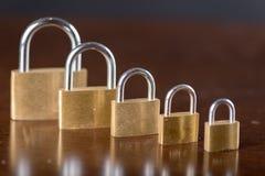 Aligned padlocks Stock Photos