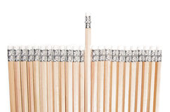 Aligned Pencils with One in Different Height Royalty Free Stock Images