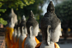 Aligned statues of Buddha Royalty Free Stock Images
