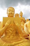 Aligned statues of Buddha Stock Photos