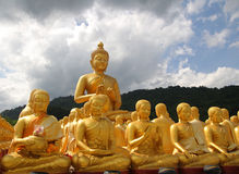 Aligned statues of Buddha Stock Photo
