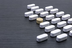 Aligned white pills Stock Photo