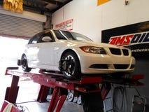 Alignement sur le blanc de BMW Photos stock