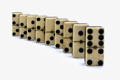 Aligning dominoes royalty free stock image