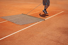 Aligning tennis court Royalty Free Stock Image