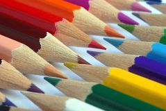 Alignment of colored pencils stock photos