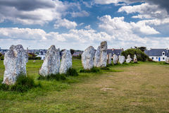 The alignment of standing stones known as Alignement de Menhirs royalty free stock photography