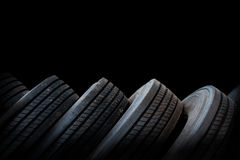 Alignment of tires in black background, used tires. Alignment of car tires in black background, used tires Royalty Free Stock Photography