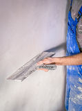 The alignment of the walls with a trowel, plaster repairs.  stock image