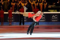 Alijona & pisco de peito vermelho na concessão dourada do patim 2011 Fotos de Stock