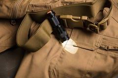 Alimenté la torche sur le tissu brun Photographie stock