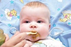 Alimentação da criança Foto de Stock