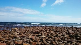 Alimenta la opinión de la playa Imagen de archivo libre de regalías