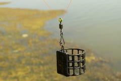 Alimentador de la jaula Imágenes de archivo libres de regalías