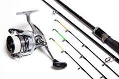 Alimentador e carretel da pesca no fundo branco Imagem de Stock Royalty Free