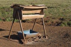 Alimentadores del ganado en la granja Fotografía de archivo libre de regalías