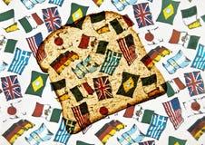 Alimente o mundo/pão e as bandeiras Foto de Stock