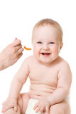 Alimenter souriant de bébé d'isolement photos libres de droits