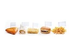 Alimenti a rapida preparazione dai paesi differenti isolati Fotografia Stock