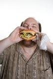 Alimenti a rapida preparazione mangiatori di uomini obesi Fotografie Stock Libere da Diritti