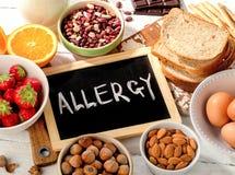 Alimento allergico su fondo di legno Fotografia Stock Libera da Diritti