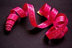 Alimento & dieta, fita de medição cor-de-rosa Imagens de Stock
