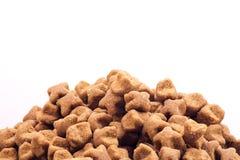Alimento asciutto isolato del cane Fotografia Stock