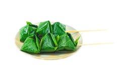 Alimento avvolto in foglie isolate Immagine Stock