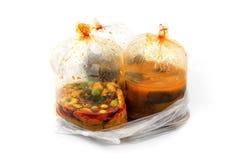 Alimento caldo nei sacchetti di plastica Immagine Stock