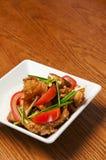 Alimento chino - tomates y pescados Fotografía de archivo