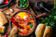 Alimento cileno Caliente di Picante I pomodori, cipolla, peperoncino rosso hanno fritto con le uova fotografia stock libera da diritti