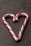 Alimento - corazón del bastón de caramelo Foto de archivo