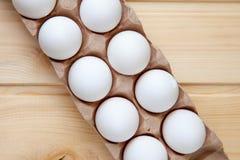Alimento da caixa do teste padrão das fileiras dos ovos Fotografia de Stock Royalty Free