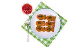 alimento das crianças Pepitas dos peixes imagens de stock