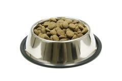 Alimento de animal doméstico en el tazón de fuente Fotografía de archivo
