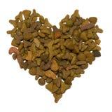 Alimento de animal doméstico en la dimensión de una variable del corazón Fotografía de archivo libre de regalías