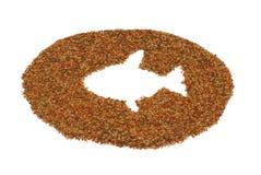 Alimento de peixes do animal de estimação Fotos de Stock