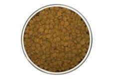 Alimento de perro seco en un plato del perro Foto de archivo